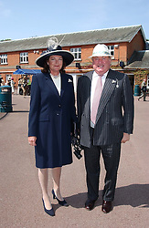 MR & MRS ANTHONY OPPENHEIMER at the King George VI and The Queen Elizabeth Diamond Stakes sponsored by De Beers for the 33rd year held at Ascot Racecourse, Berkshire on July 24th 2004.
