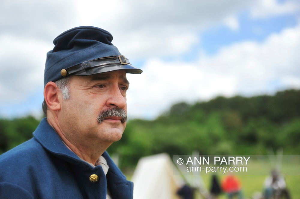 Old Bethpage, New York, USA - July 21, 2012: GENE MONGELLO of Levittown, NY portrays a soldier at re-creation of Camp Scott, a Union Army training camp, at Old Bethpage Village Restoration, to commemorate 150th Anniversary of American Civil War.