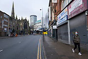 National coronavirus lockdown three begins in Birmingham city centre, which is deserted apart from a few people walking to a bus stop in Digbeth on 6th January 2021 in Birmingham, United Kingdom. Following the recent surge in cases including the new variant of Covid-19, this nationwide lockdown, which is an effective Tier Five, came into operation today, with all citizens to follow the message to stay at home, protect the NHS and save lives.