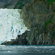 Aialik Glacier meets the waters of Aialik Bay in Kenai Fjords National Park Alaska