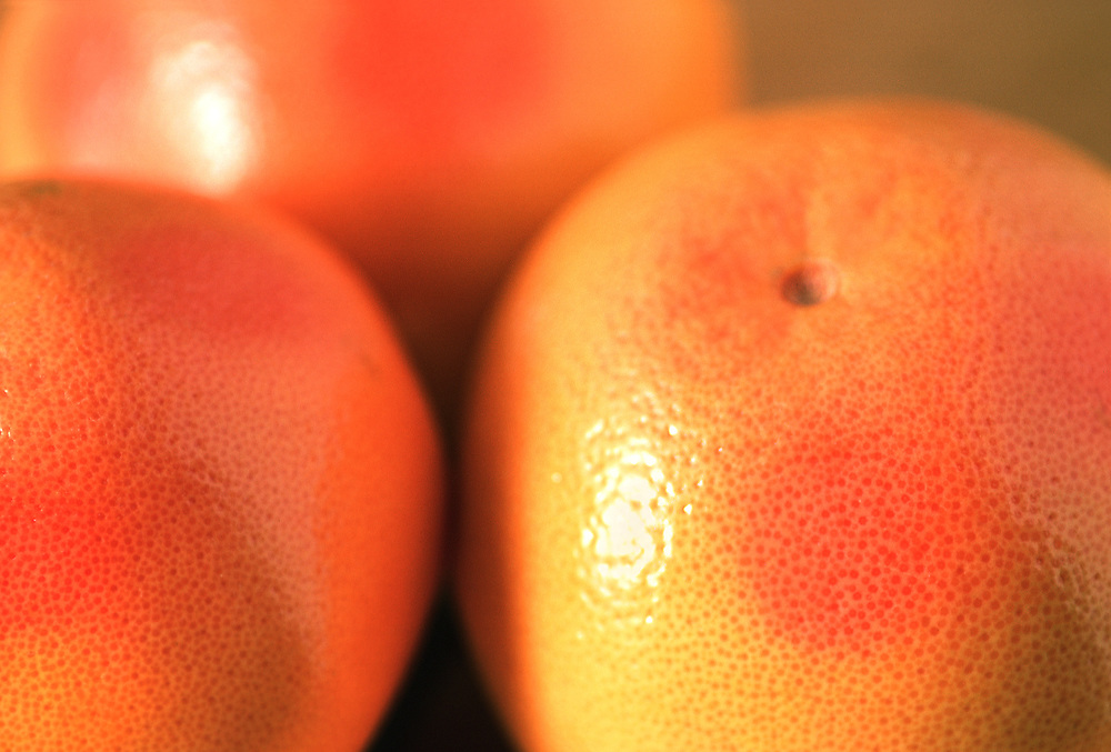 Extreme close up selective focus photograph of a few Red Grapefruits