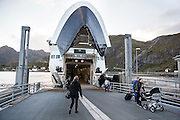 The car ferry from Bodo unloads pedestrians at the dock at Moskenes, Lofoten Islands, Norway.