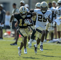 July 28, 2018 - Metairie, LA, U.S. - METAIRIE, LA. - JULY 28:  New Orleans Saints wide receiver Tommylee Lewis (11) and cornerback De'Vante Harris (25) run through a drill during New Orleans Saints training camp practice on July 28, 2018 at the Ochsner Sports Performance Center in New Orleans, LA.  (Photo by Stephen Lew/Icon Sportswire) (Credit Image: © Stephen Lew/Icon SMI via ZUMA Press)
