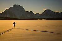 A young man nordic skis on Jackson Lake in Grand Teton National Park, Jackson Hole, Wyoming.
