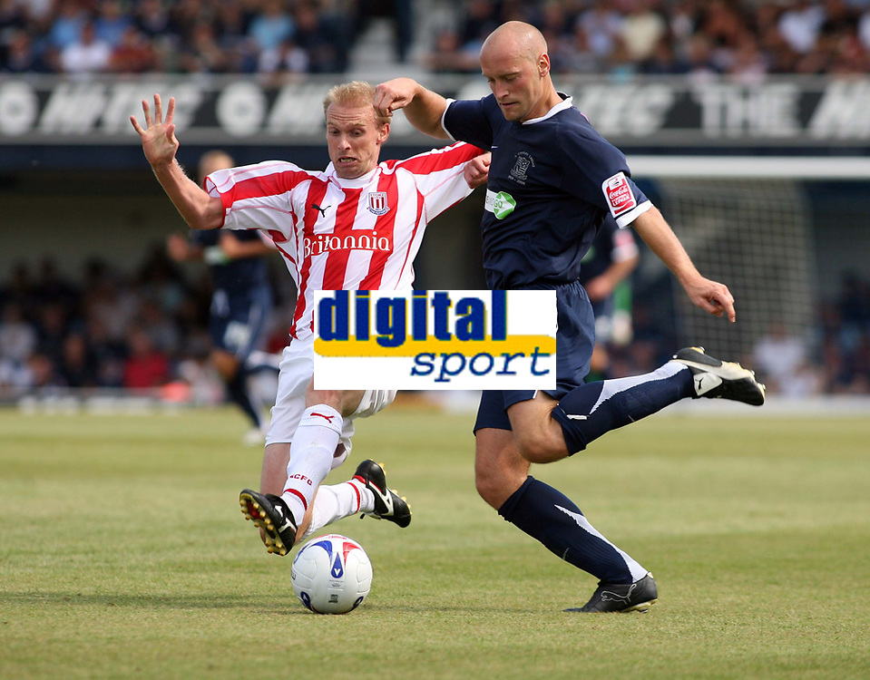 Photo: Chris Ratcliffe.<br />Southend United v Stoke City. Coca Cola Championship.<br />05/08/2006.<br />Luke Chadwick of Stoke City (L) clashes with Adam Barrett of Southend.