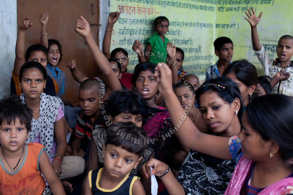 Children are taking part to an awareness workshop organised by Neeta Shani, from the charity PVCHR, in Parmandapur, a rural area near Varanasi, Uttar Pradesh, India.