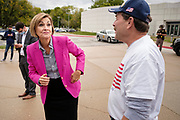 28 SEPTEMBER 2020 - JOHNSTON, IOWA: Governor KIM REYNOLDS (R-IA) talks to supporters of US Senator Joni Ernst before the US Senate debate at the Iowa PBS studios in Johnston. Both US Senator Joni Ernst, the Republican incumbent, and Theresa Greenfield, the Democratic challenger, had rallies before the debate. Polling puts the race within the margin of error.    PHOTO BY JACK KURTZ