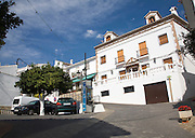 Whitewashed buildings in the Andalucian village of Alcaucin , Malaga province, Spain