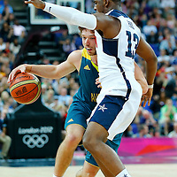 08 August 2012: Australia Matt Dellavedova is blocked by Chris Paul during 119-86 Team USA victory over Team Australia, during the men's basketball quarter-finals, at the 02 Arena, in London, Great Britain.