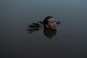 Gabriel Senencina, 50, swims in the Cashibo lake in the Rainforest after being under a strict 5-month quarantine, locked up in the city of Lima in an overpopulated indigenous community without drinking water or food. Only in July 2020, Senencina was able to return to the Amazon, his place of origin