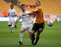 Photo: Rich Eaton.<br /> <br /> Wolverhampton Wanderers v Luton Town. Coca Cola Championship. 26/08/2006. Kevin Foley left of Luton challengs Daniel Jones of Wolves