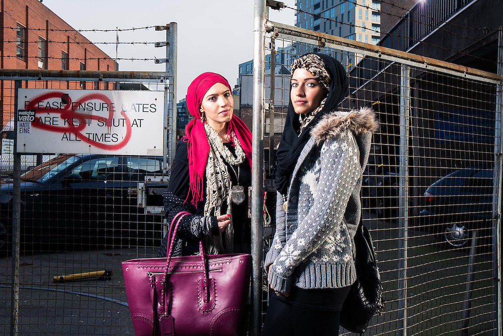 Hiba Alhejazi  (Red Hajib) aged 23  who has an MA in Middle Eastern Politics & her sister Saryah (leopard print Hijib)  photographed in Brick Lane, London on Monday 20th January 2014.<br /> Muslim fashion easters have come into the headlines after a You Tube sensation called the Mipsterz.<br /> <br /> photo by Ki Price