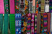 Colourful Guatemalan textiles in San Juan la Laguna, one of the villages on the banks of Lake Atitlan. It is smaller than many of the other towns and with many pess toruists, which has allowed it to preserve much of its traditional culture, which is making textiles with natural dyes. Lake Atitlan is seen as the most important single tourist attraction in Guatemala; and is Central Americas deepest lake. There are many villages on the banks of the lake; each with different identity and culture; the majority of the population in the region identify as indigenous Maya and many still wear traditional dress and speak Maya languages.