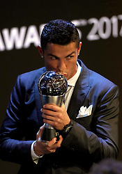 Cristiano Ronaldo kisses his award for FIFA Men's Player of the Year during the Best FIFA Football Awards 2017 at the Palladium Theatre, London.