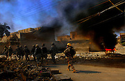 Members of the U.S. and Iraqi Army set fire to a car laden with explosives after discovering it abandoned during combat operations in New Baqubah, Iraq, on March 2, 2007. Photo by Stacy L. Pearsall