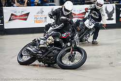 Hooligan Joshua McDonald races into turn one at the Flat Out Friday flat track racing on the Dr. Pepper-covered track in the UW-Milwaukee Panther Arena during the Harley-Davidson 115th Anniversary Celebration event. Milwaukee, WI. USA. Friday August 31, 2018. Photography ©2018 Michael Lichter.