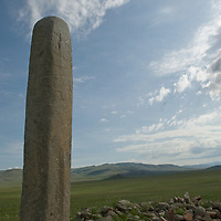 "2700+ year-old, bronze age Deer Stone at Ulaan Tolgai site near Lake Erkhel & Moron, Mongolia.  A ""khirigsuur"" burial mound of similar age is in the background."