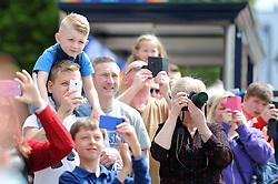 Bristol City fans look on as the Bristol City celebration tour bus goes past - Photo mandatory by-line: Dougie Allward/JMP - Mobile: 07966 386802 - 04/05/2015 - SPORT - Football - Bristol -  - Bristol City Celebration Tour