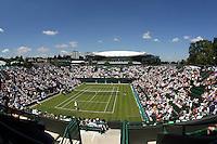 Court 1 ground view of the match between Caroline Wozniacki (DEN)  Kimiko Date Krumm (JPN)<br /> <br /> Tennis - Wimbledon Lawn Tennis Championships - Day 2 Tue 23 Jun 2009 -  All England Lawn Tennis and Croquet Club - Wimbledon - London - England<br /> <br /> © CameraSport - 43 Linden Ave. Countesthorpe. Leicester. England. LE8 5PG - Tel: +44 (0) 116 277 4147 - admin@camerasport.com - www.camerasport.com
