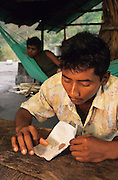 GOLD & DIAMONDS Amazon, southern Venezuala, South America. Man at table with diamonds abnd gold. Gold and diamond panners, mining for gold and silver in the rivers. Ecological biosphere and fragile ecosystem where flora and fauna, and native lifestyles are threatened by progress and development. The rainforest is home to many plants and animals who are endangered or facing extinction. This region is home to indigenous primitive and tribal peoples including the Yanomami and Macuxi.