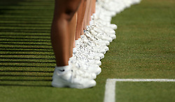 A view of ball girls and ball boys feet during the Final of the 2017 AEGON Championships at The Queen's Club, London. PRESS ASSOCIATION Photo. Picture date: Sunday June 25, 2017. See PA story TENNIS Queens. Photo credit should read: Steven Paston/PA Wire. RESTRICTIONS: Editorial use only, no commercial use without prior permission.