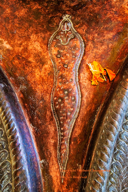 """Holy Sperm:  This close-up view of a Hindu lingam finds carved into the yoni a sperm like representation, found in the ancient Shiva temple, Shri Panchvaktar Temple in Jammu India. <br /> <br /> The lingam is often represented alongside the yoni (Sanskrit word, literally """"origin"""" or """"source"""" or """"womb)."""