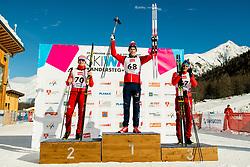 January 31, 2018 - Goms, Switzerland - Denis Spitsov of Russia, Mattis Stenshagen of Norway and Ivan Yakimushkin of Russia on the podium after the men's 15km classic technique interval start during the FIS U23 Cross-Country World Ski Championships. (Credit Image: © Vegard Wivestad Gr¯Tt/Bildbyran via ZUMA Press)