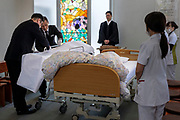 The undertaker from the funeral home covers the body of Yasutaro Koyama, 89, at his farewell party on November 29th, 2019 at Aiwa Hospice in Nagano, Japan. Yasutaro hospitalized for cancer 2 days ago after receiving treatment from the hospice remotely at his house for about a year.