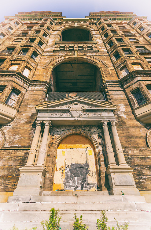 The Divine Lorraine Hotel, also known as the Lorraine Apartments, stands at the corner of Broad Street and Fairmount Avenue in North Philadelphia, Pennsylvania. Designed by architect Willis G. Hale and built between 1892 and 1894, the building originally functioned as apartments, housing some of Philadelphia's wealthy residents. Lorraine Apartments was one of the most luxurious and best preserved late 19th-century apartment houses in Philadelphia. In 1900 the building became the Lorraine Hotel when the Metropolitan Hotel Company purchased the apartments. Later it would become the first hotel in Philadelphia to be racially integrated under Father Divine.<br /> <br /> The Lorraine, at ten stories tall, was one of the first high-rise apartment buildings in the city. The building's architect, Willis G. Hale, also designed an earlier high-rise apartment building at 22nd and Chestnut Streets, which stood from 1889 until its demolition in 1945. Hale designed many other buildings around the city, but quickly fell out of favor at the turn of the century when most patrons rejected his highly stylized Victorian designs for the sleeker style of modern skyscrapers, and most of his landmarks had been torn down after the Great Depression.<br /> <br /> The building was closed in 1999 and sold in 2000 by the International Peace Mission. In May 2006 it was resold to Lorraine Hotel LP. to be converted into apartments. Development has stalled however, and the building remains in a dilapidated state, covered with graffiti, with windows boarded up or open to the weather.