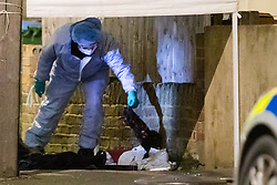 © Licensed to London News Pictures. 06/03/2019. London, UK.  Forensic officers remove items under the forensic tent at the crime scene in North Birkbeck Road in Leyton where a murder investigation has been launched after a man was stabbed this afternoon at around 16:26hrs.  Photo credit: Vickie Flores/LNP