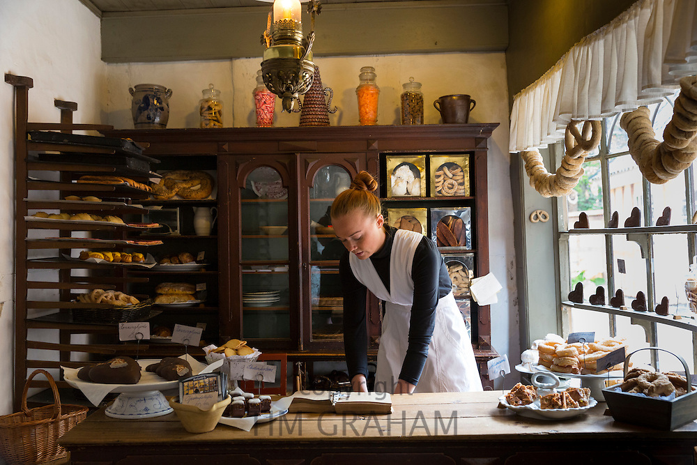 Costume character in period bakery at Den Gamle By, The Old Town, folk museum at Aarhus, Denmark