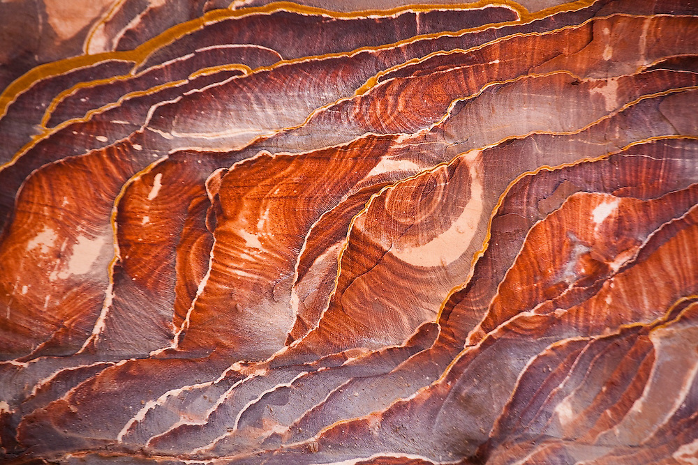 Detail of colorful rock patterns in the cliffs of Petra, Jordan.