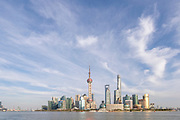 View of the futuristic cityscape of Lujiazui skyline and the Huangpu river seen from the Bund, Shanghai, China