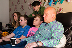 THE SUN - The Wells family - Alfie, 14, mum Jodie, twins Luke and Pacey, 13, with Dad kirk Wells watch Saturday Night Takeaway at their home in Feering near Colchester. Declan 'Dec' Donnelly  presents the programme without his long term co-presenter Ant McPartlin, who has taken time out to attend rehabilitation for addiction issues following a road accident in Richmond. Colchester, Essex, March 30 2018.