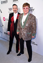 David Furnish (left) and Elton John attending the Elton John AIDS Foundation Viewing Party held at West Hollywood Park, Los Angeles, California, USA.