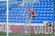 Gareth Bale of Wales jumps over the advertising boards as he gets his ball back from the stand  during Wales football team training session at the Cardiff city stadium  in Cardiff, South Wales  on Monday 12th October 2015. The team are training ahead of their final Euro 2016 qualifying against Andorra tomorrow.<br /> pic by  Mark Hawkins, Andrew Orchard sports photography.