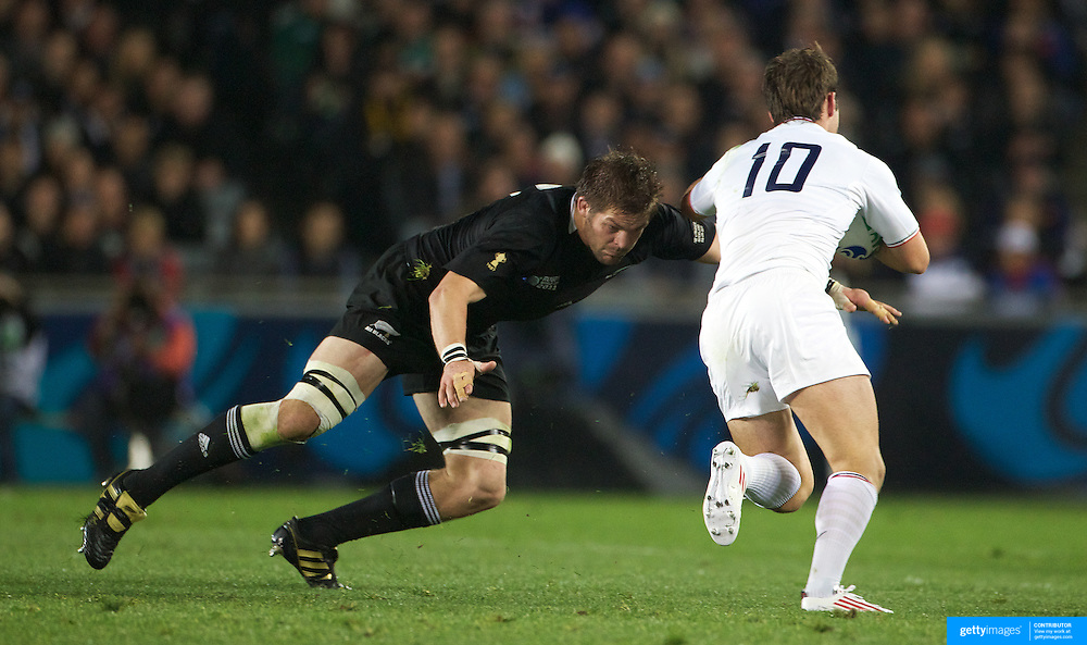 Richie McCaw, New Zealand, playing is 100th test match, tackles Morgan Parra, France,  during the New Zealand V France, Pool A match during the IRB Rugby World Cup tournament. Eden Park, Auckland, New Zealand, 24th September 2011. Photo Tim Clayton...