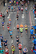 Lucozade being handed out at the London Marathon on 28th April 2019 in London, England, United Kingdom. The London Marathon, presently known through sponsorship as the Virgin Money London Marathon, is a long-distance running event. The event was first run in 1981 and has been held in the spring of every year since. The race is mainly known for ebing a public race where ordinary people can challenge themsleves while raising great amounts of money for various charities.