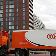 TNT truck parked in front of building