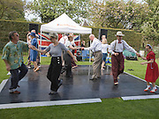 People performing dances to 1940s swing music during a country fair, Helmingham Hall, Suffolk, England