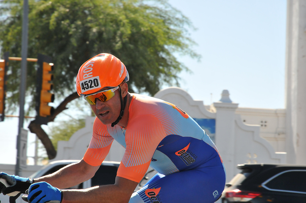 El Tour de Tucson 2017 finisher rounding the race's final corner at 22nd Street and 6th Avenue. Bike-tography by Martha Retallick.
