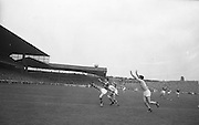 All Ireland Senior Football Championship Final, Kerry v Roscommon, Kerry 1-12 Roscommon 1-6, 23.09.1962, 09.23.1962, 23rd September 1962, 23091962AISFCF,..G McMahon (Kerry) tries an overhead kick as Roscommon players G.O'Reilly and J.Lynch harass him, .Referee: E. Moules (Wicklow),.Captain: S.g Sheehy,..Attendance: 75,771,