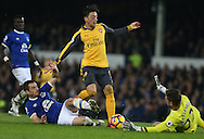 Leighton Baines of Everton and Maarten Staklenburg of Everton combine to deny Mesut Ozil of Arsenal during the English Premier League match at Goodison Park Stadium, Liverpool. Picture date: December 13th, 2016. Pic Simon Bellis/Sportimage