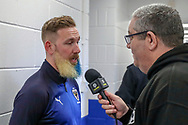 AFC Wimbledon midfielder Scott Wagstaff (7) being interviewed during the The FA Cup 5th round match between AFC Wimbledon and Millwall at the Cherry Red Records Stadium, Kingston, England on 16 February 2019.