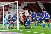Scott McKenna (26) of Nottingham Forset clears the ball off the line as Dominic Solanke (9) of AFC Bournemouth closes in during the EFL Sky Bet Championship match between Bournemouth and Nottingham Forest at the Vitality Stadium, Bournemouth, England on 24 November 2020.