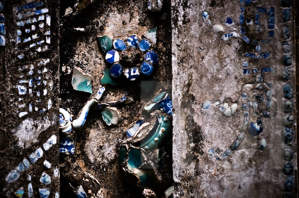 Blue mosaic on a wall of a traditional house of Hoi An, Vietnam, Asia
