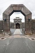 Entrance arches and doorway to Dartmoor prison, Princetown, Devon, England, UK