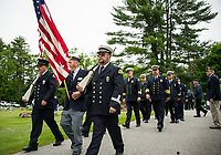 The Meredith Center Color Guard marching through Oakland Cemetery during Memorial Day services held Monday morning.  (Karen Bobotas/for the Laconia Daily Sun)