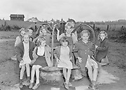 0003-010. Merry go round with children at Evaline Elementary school, near Winlock, Washington. There is a 1936 date in the concrete foundation. The photographer, Stuart Fresk, was a teacher there from 1935 to 1946.