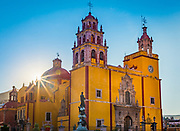 Basilica in Guanajuato, Mexico<br /> ------<br /> Guanajuato is a city and municipality in central Mexico and the capital of the state of the same name. It is part of the macroregion of Bajío. It is in a narrow valley, which makes its streets narrow and winding. Most are alleys that cars cannot pass through, and some are long sets of stairs up the mountainsides. Many of the city's thoroughfares are partially or fully underground. The historic center has numerous small plazas and colonial-era mansions, churches and civil constructions built using pink or green sandstone.<br /> <br /> The origin and growth of Guanajuato resulted from the discovery of minerals in the mountains surrounding it. The mines were so rich that the city was one of the most influential during the colonial period. One of the mines, La Valenciana, accounted for two-thirds of the world's silver production at the height of its production.<br /> <br /> The city is home to the Mummy Museum, which contains naturally mummified bodies that were found in the municipal cemetery between the mid 19th and 20th centuries. It is also home to the Festival Internacional Cervantino, which invites artists and performers from all over the world as well as Mexico. Guanajuato was the site of the first battle of the Mexican War of Independence between insurgent and royalist troops at the Alhóndiga de Granaditas. The city was named a World Heritage Site in 1988.